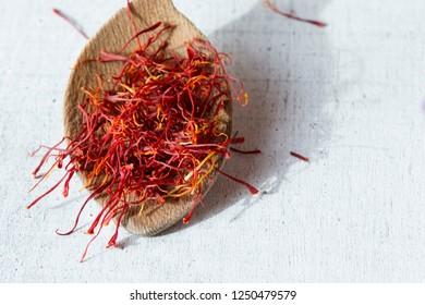 Dried saffron spice in a spoon, copy space