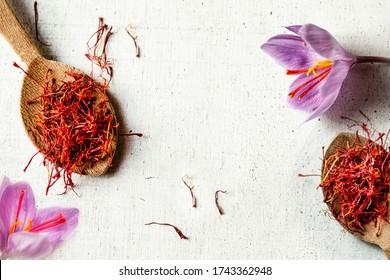 Dried saffron spice  in a spoon and Saffron flower