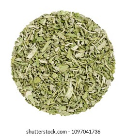 Dried sage. Herb circle from above, isolated, over white. Disc made of chopped common sage. Salvia officinalis. Grayish herb, spice and medical plant. Closeup. Macro food photo.