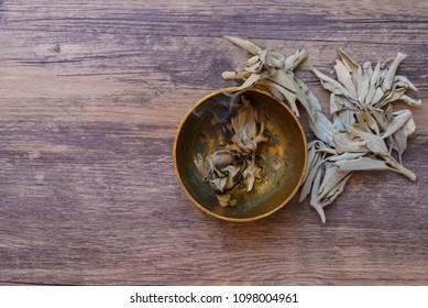Dried sage leaves burning