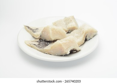 Dried and salted cod on a dish