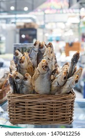 Dried salted perch fish in basket close up, dry sea bass sale on seafood market, tasty stockfish, jerky grouper, salty cooked sunfish, traditional gourmet beer snack, delicious prepared salty snapper