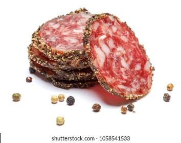Dried sliced organic salami sausage on white background