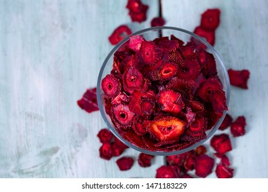 dried sliced strawberry on a wooden surface