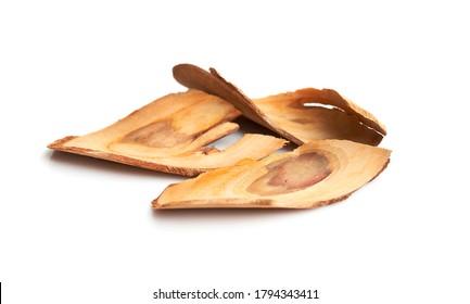Dried and sliced tongkat-ali,long jack (Eurycoma longifolia) isolated in white background.