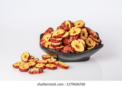 Dried slices of jujube on white background