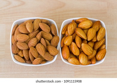 Dried and soaked Shelled Almond on wooden background, top view