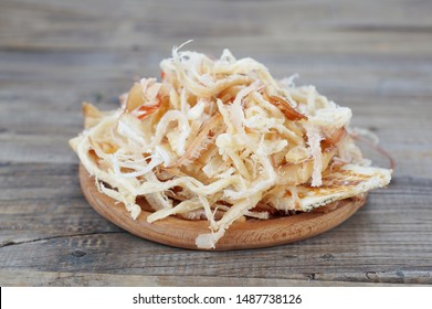 dried squid isolated on wood background.