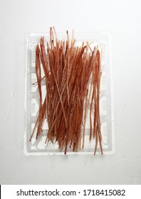 Dried squid slices photographed on dark gray background