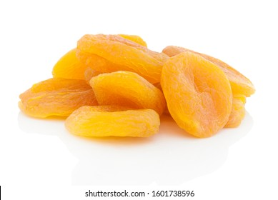 Dried stoneless apricots. Isolated on white background with shadow reflection. With clipping path. With vector path. Dried heap of apricots on white bg. Dried fruits on white glossy underlay.