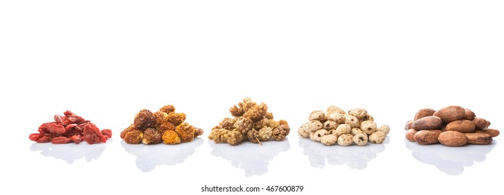 Dried super food tiger nuts, mulberry berries, cacao beans, goji berries, golden berry over white background