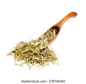 Dried Sweetgrass (Hierochloe) on the wooden spoon.