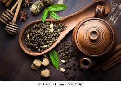 Dried tea leaves with tea pot