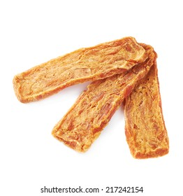 Dried three meat strip snacks composition, isolated over the white background