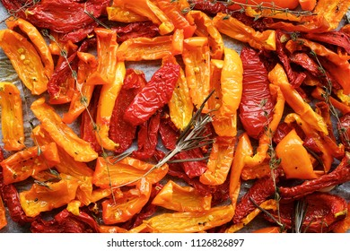 Dried tomatoes with herbs. Top view food background