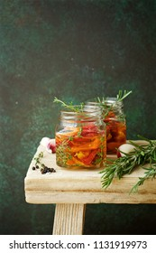 Dried tomatoes preserves with herbs in jar