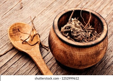 Dried Valerian roots on wooden background.Valeriana officinalis
