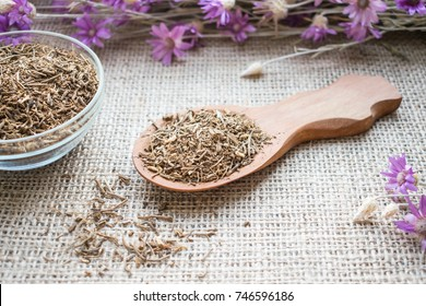 Dried Valerian roots in wooden spoon on sackcloth background. Valeriana officinalis, Caprifoliaceae in herbal medicine. Valerian Root for Anxiety and Sleep as nutritional supplement for health