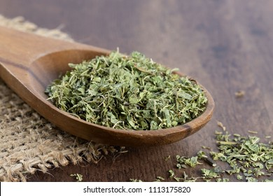 dried verbena officinalis on a wooden spoon