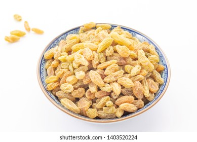 Dried vine fruit of raisins or sultanas in porcelain bowl isolated on white background,studio shot