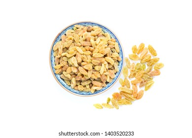 Dried vine fruit of raisins or sultanas in porcelain bowl isolated on white background,top view studio shot