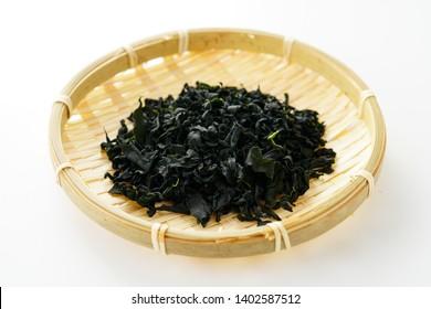 Dried wakame seaweed on white background.