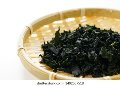 Dried wakame seaweed on white background.