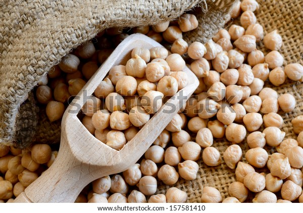 dried white chickpeas ceci on sack close up