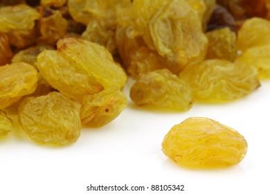 dried white raisins on a white background