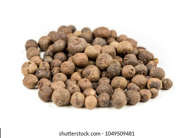 Dried whole allspice isolated on a white background