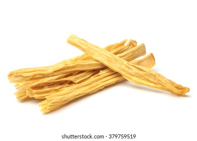 Dried yuba sticks or Fuzhu on white background