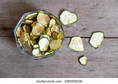 Dried zucchini in a wood bowl,chips oven baked
