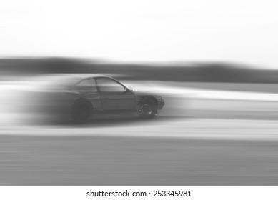 drift car motion blur on vintage black and white