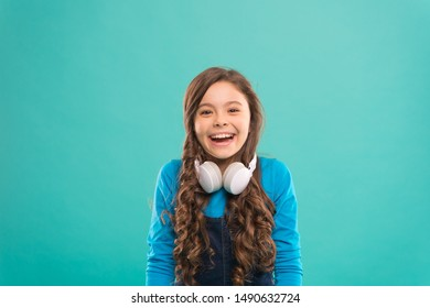 Drift into the music. Happy little DJ on blue background. Cute girl smiling with DJ headphones. Small child using wireless headset for DJ disco. Adorable kid enjoying DJ tune playing in radio.
