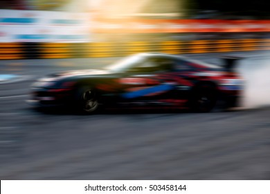 Drift racer,Race car racing on speed track with motion blur.