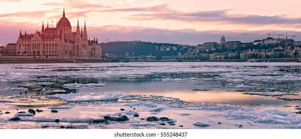 Drifting ice in the river Danube at parliament in winter Budapest, Hungary