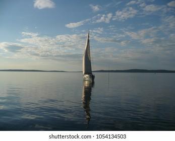 Drifting sailer in calm water