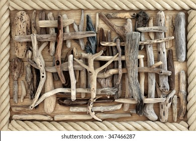 Driftwood abstract background on oak wood surrounded by rope.
