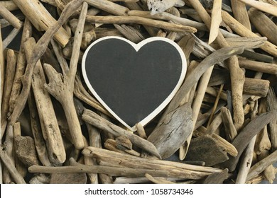 Driftwood frame. Driftwood Mockup. heart frame. frame from heart chalk board and dry sea driftwood . Blank empty . copy space