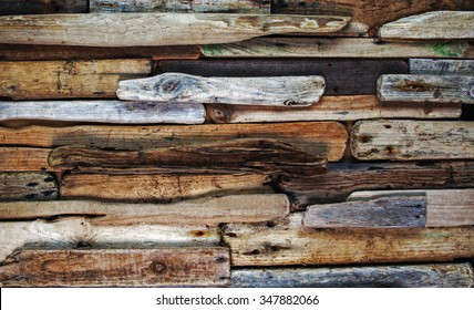 Driftwood, knotty wood planks, as a wooden abstract background texture.