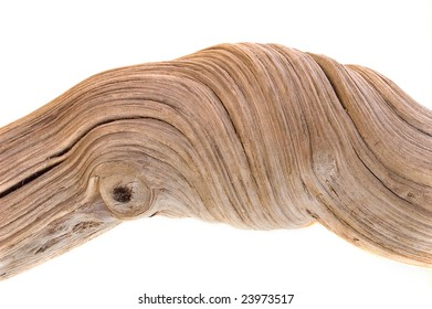 driftwood on white background with strong twisted grain and knots