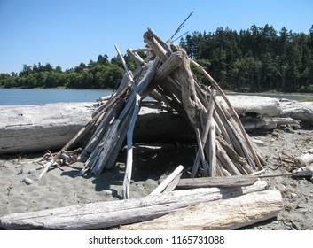 Driftwood wind shelter on Dungeness Spit beach, a national wildlife refuge near Port Angeles, Washington, USA, and world's longest natural sand spit.