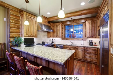 Driggs, Idaho, USA Oct. 27, 2014  The kitchen in a modern log cabin in the mountains, with cabinets, modern stainless steel appliances, and counter top bar.