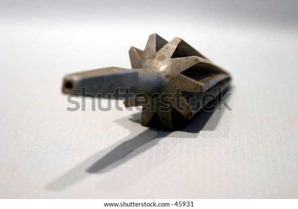 a drill bit on gray background