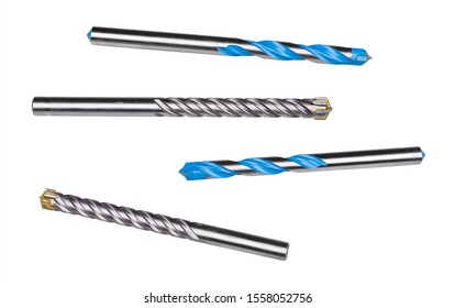 Drill bits for drilling masonry, stone or concrete isolated on white background. Set of steel spiral fluted cutters with cemented carbide cutting edges or blue surface finishing. Silvery metal tools.