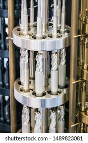 Drill bits in various sizes on the drill bit rack for Metalworking. Parts and parts of machine tools for Metalworking