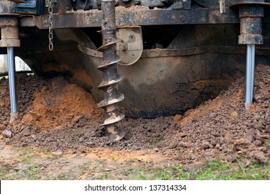 drill is digging a hole
