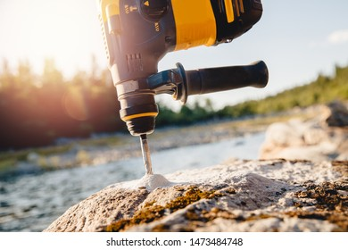 Drill for holes in stone and brick walls, professional tool.
