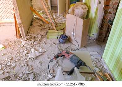 Drill on the dirty and dusty floor in a house under construction.