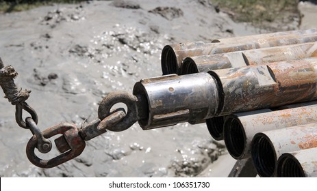 Drill pipe on oil rig. Oil and Gas Industry. Drilling Rig. Lifting drill pipe from horizontal position on a drilling rig.